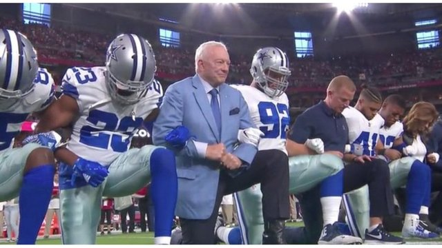 Dallas Cowboys kneel, then rise before start of national anthem