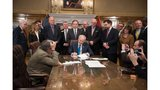 Arkansas Governor signs bill cutting top income tax rate